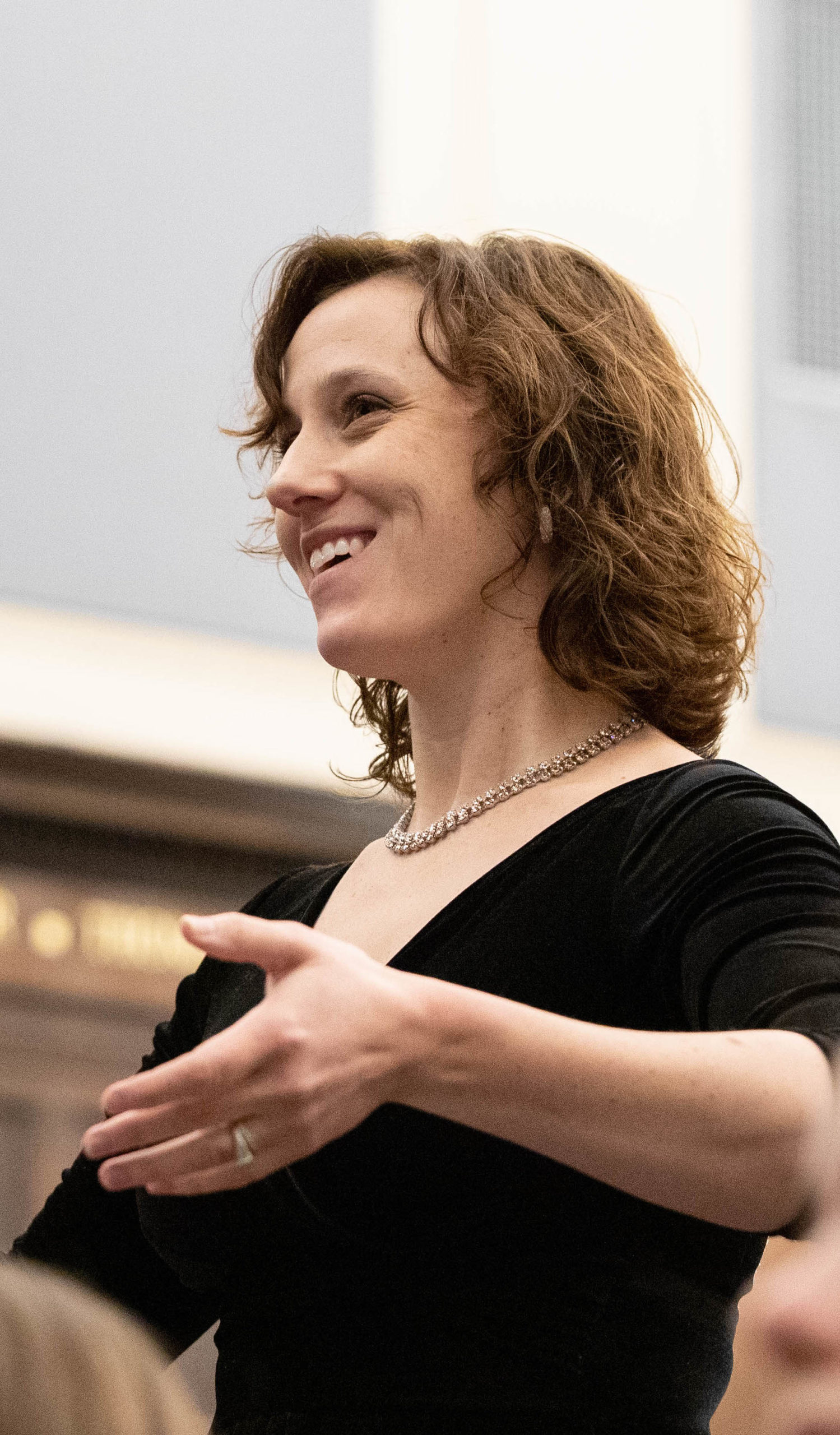 Conductor Alyson Greer Espinosa conducting