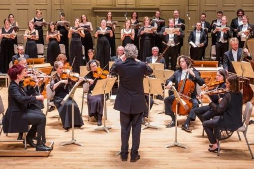 Artistic Director Harry Christophers conducting the Orchestra and Chorus