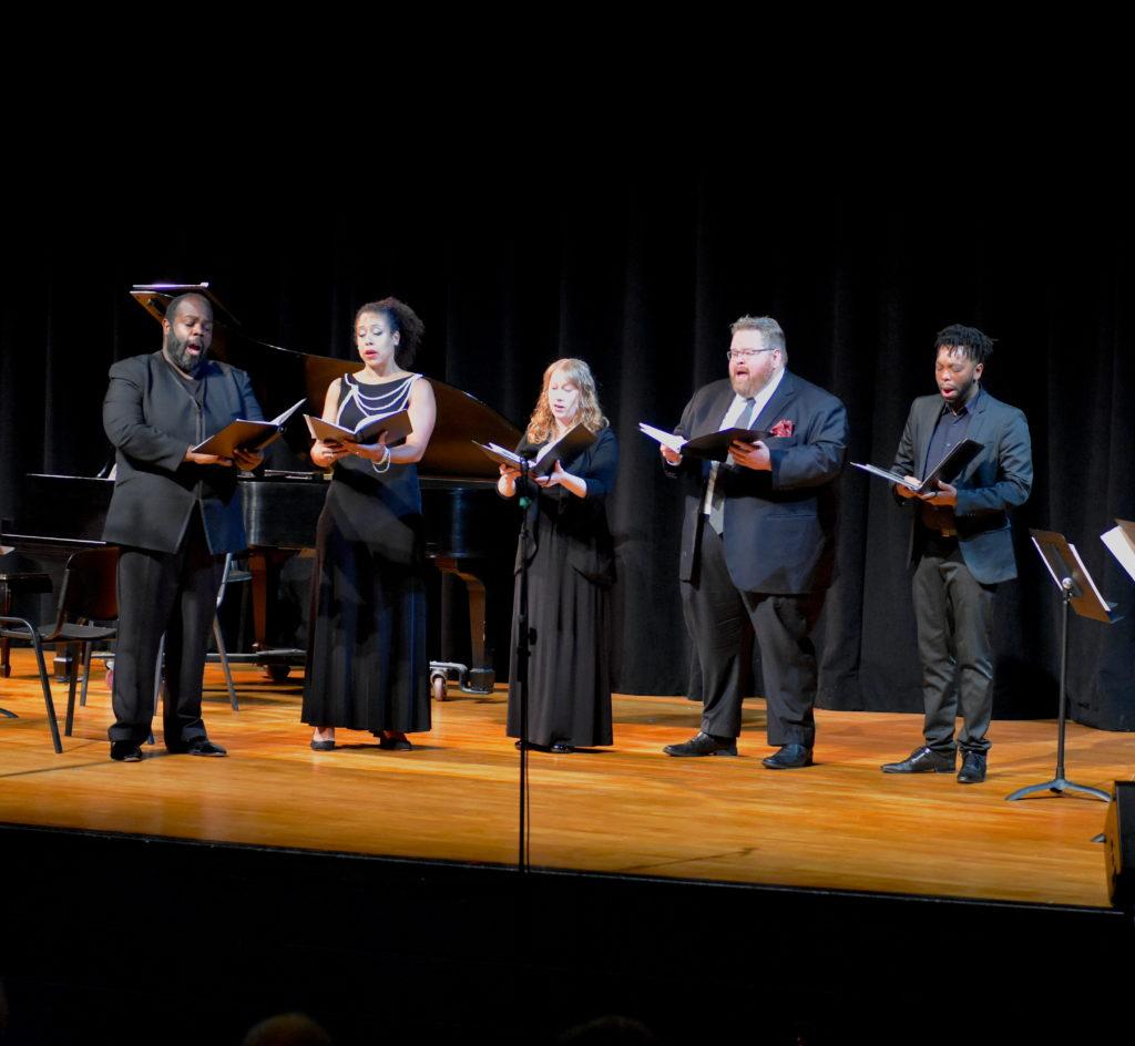 A group of Chorus members singing