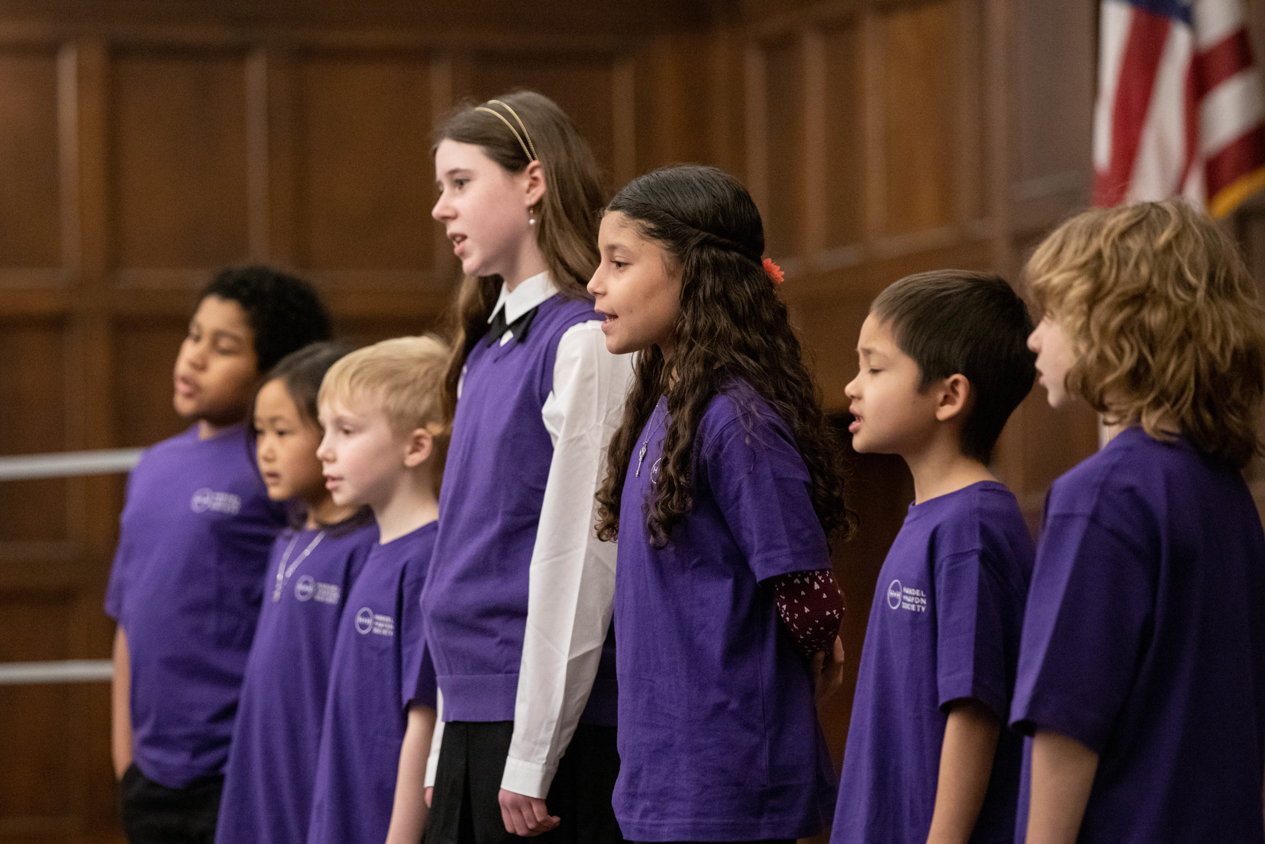 Young choral students singing