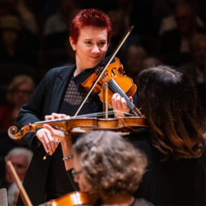 Concertmaster Aisslinn Nosky playing