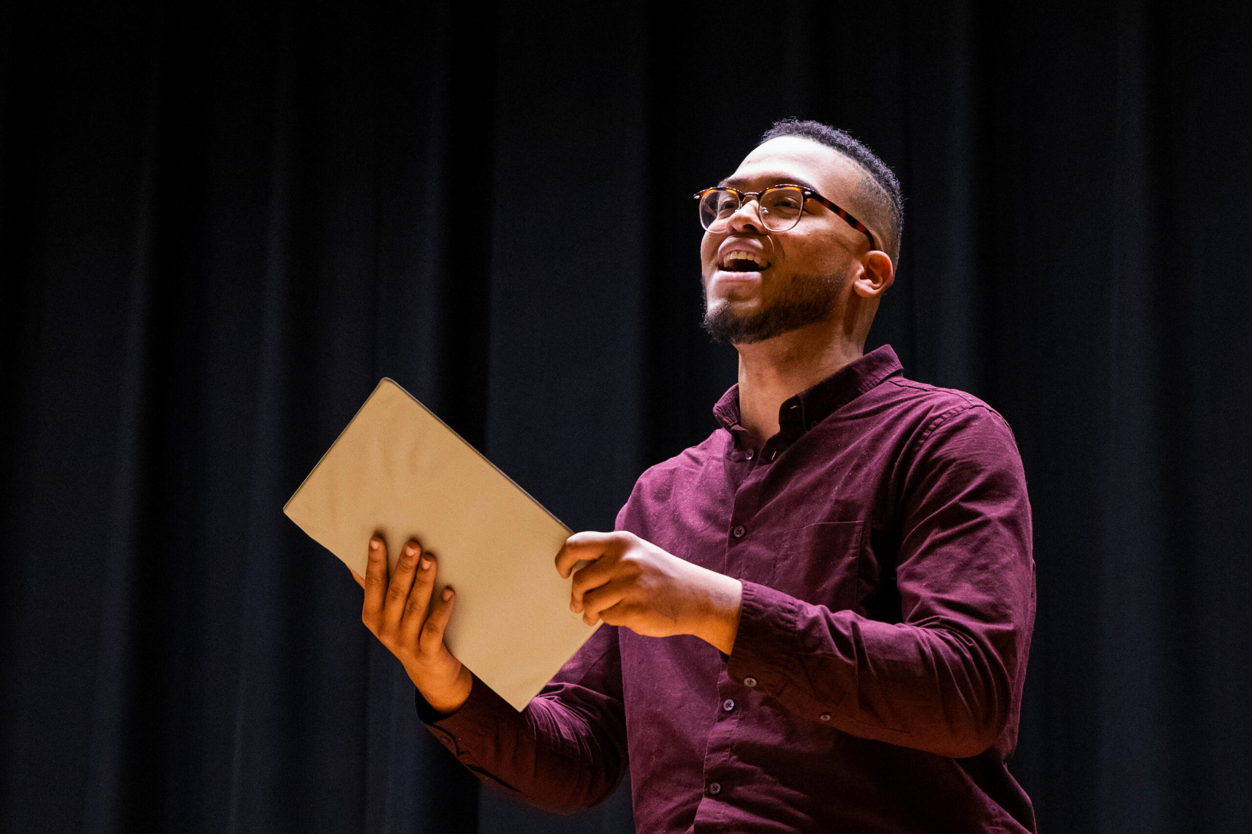 Young Black male student singing