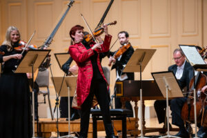 Concertmaster Aisslinn Nosky performs with the H+H Orchestra